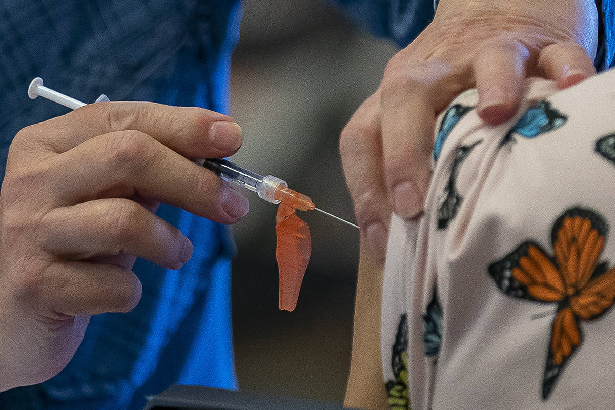 A person receives a COVID-19 vaccine at a vaccination clinic run by Vancouver Coastal Health, in Richmond, B.C., Saturday, April 10, 2021. THE CANADIAN PRESS