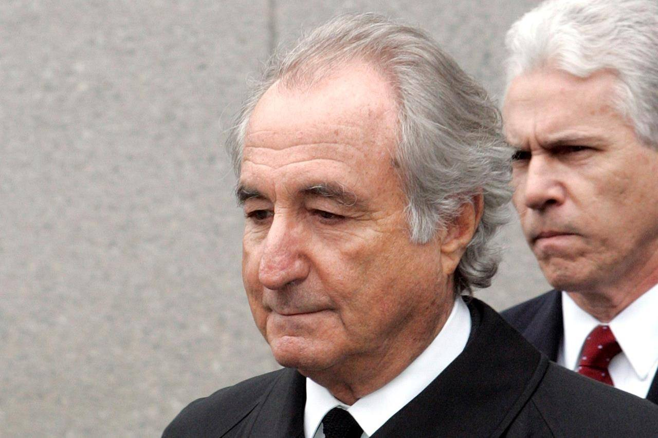 FILE - In this Tuesday, March 10, 2009, file photo, former financier Bernie Madoff exits federal court in Manhattan, in New York. Madoff, the financier who pleaded guilty to orchestrating the largest Ponzi scheme in history, has died in prison, a person familiar with the matter tells The Associated Press(AP Photo/David Karp, File)