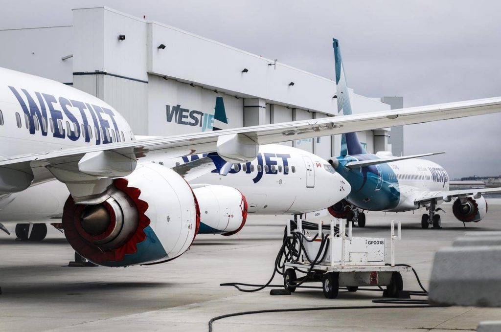 Grounded WestJet Boeing 737 Max aircrafts are shown at the airline's facilities in Calgary, Alta., Tuesday, May 7, 2019. WestJet says it will extend its temporary suspension of international sun flights to destinations in Mexico and the Caribbean until June 4. THE CANADIAN PRESS/Jeff McIntosh