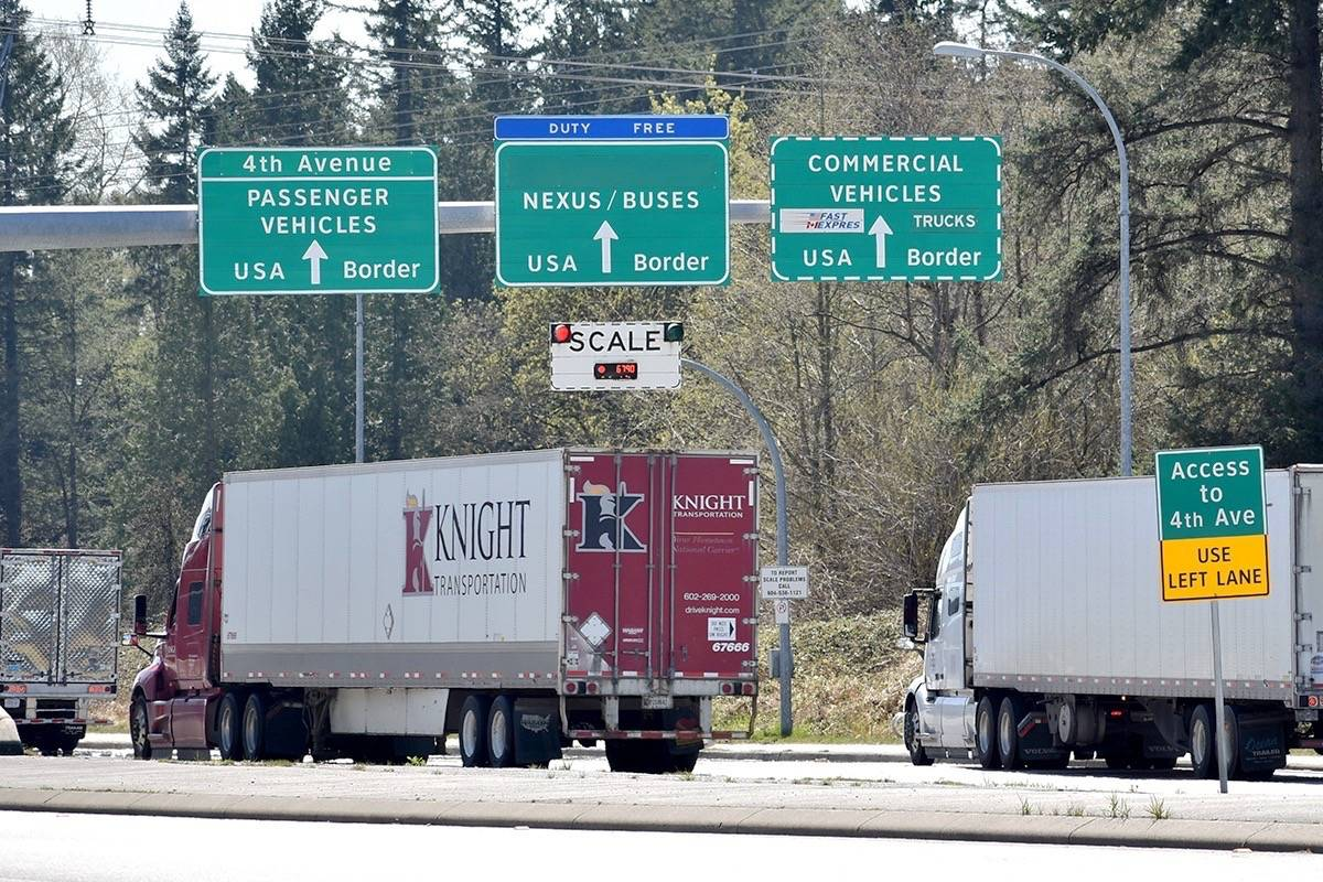 Commercial trucks head south towards the Pacific Highway border crossing Wednesday (April 14, 2021). The union representing Canadian border officers wants its members to be included on the frontline priority list for the COVID-19 vaccine. (Aaron Hinks photo)