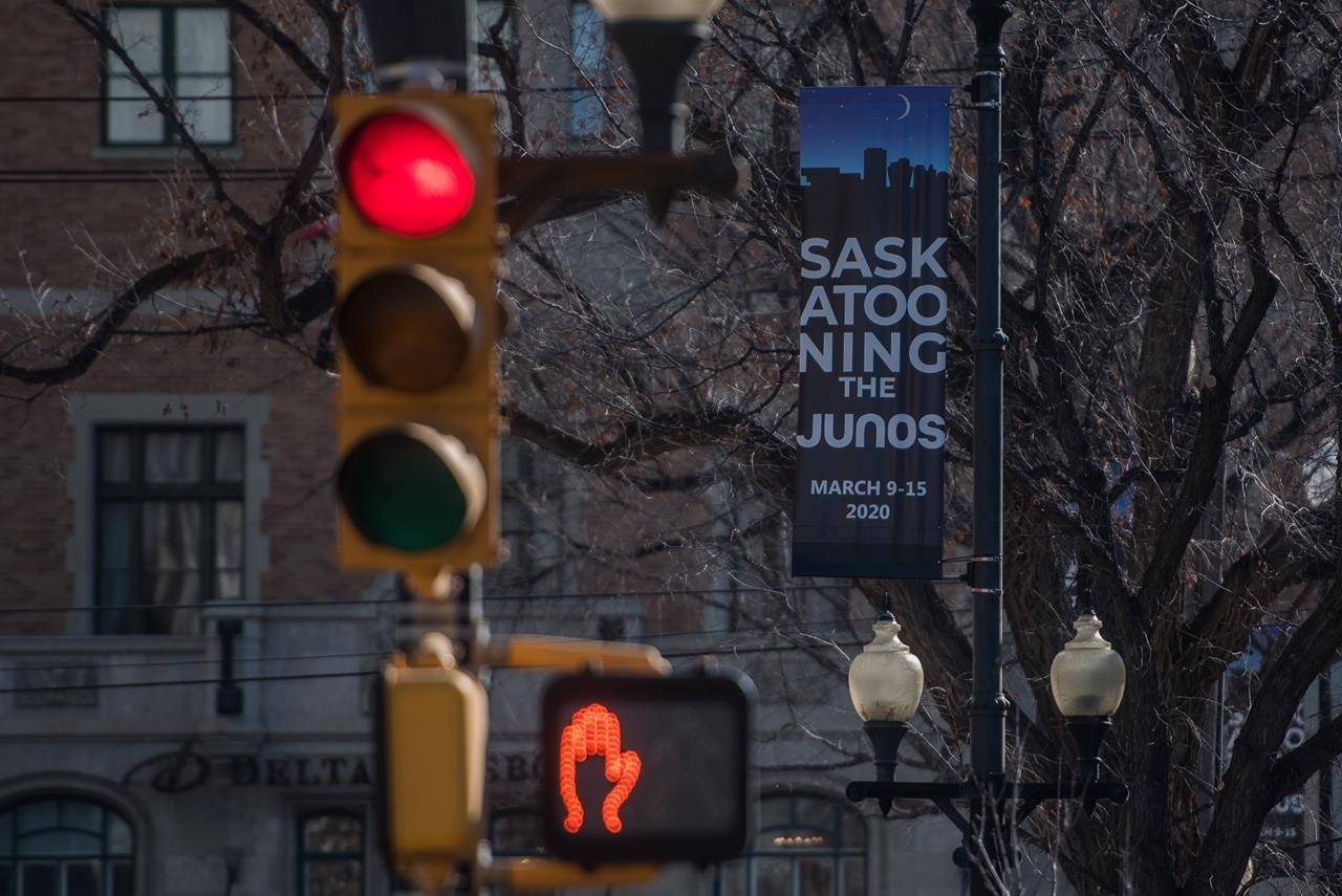 """Juno Awards signage hangs in downtown Saskatoon on Thursday, March 12, 2020. Organizers of the Juno Awards say they've postponed this year's 50th-anniversary celebration until June 6 """"out of an abundance of caution in response to the evolving COVID-19 pandemic."""" THE CANADIAN PRESS/Matt Smith"""