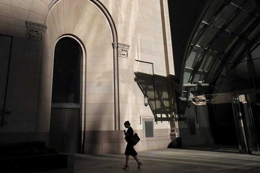 A woman walks through Toronto's financial district on Monday, July 30, 2018. Women remain underrepresented in boardrooms of Canadian companies listed on the Toronto Stock Exchange despite the introduction of disclosure requirements intended to boost their numbers, a study by the Conference Board of Canada has found. THE CANADIAN PRESS/Graeme Roy