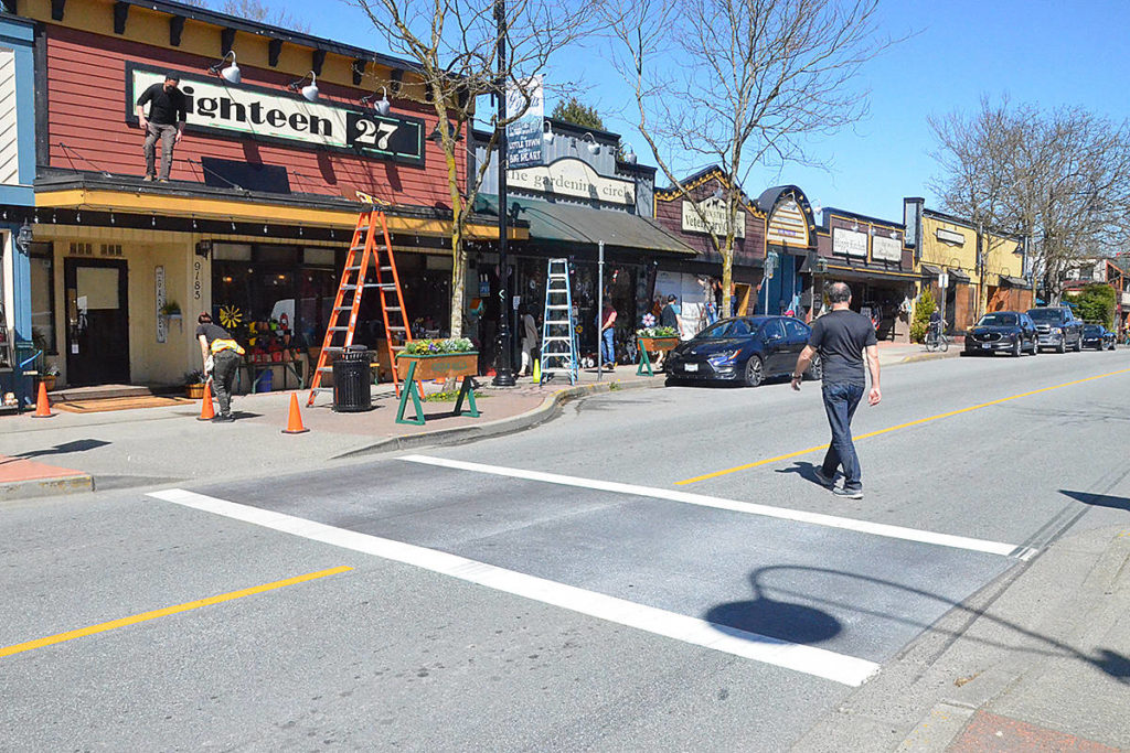 The rainbow crosswalk at Glover Road and Mary Avenue in Fort Langley has been temporarily covered up for the filming of a movie. (Matthew Claxton/Langley Advance Times)