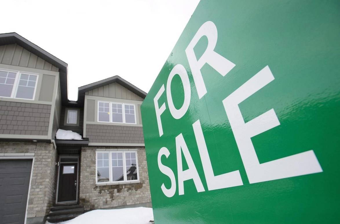 A for sale sign is shown in by new homes in Beckwith, Ont., just outside Ottawa, on Wednesday, Jan. 11, 2018. THE CANADIAN PRESS/Sean Kilpatrick