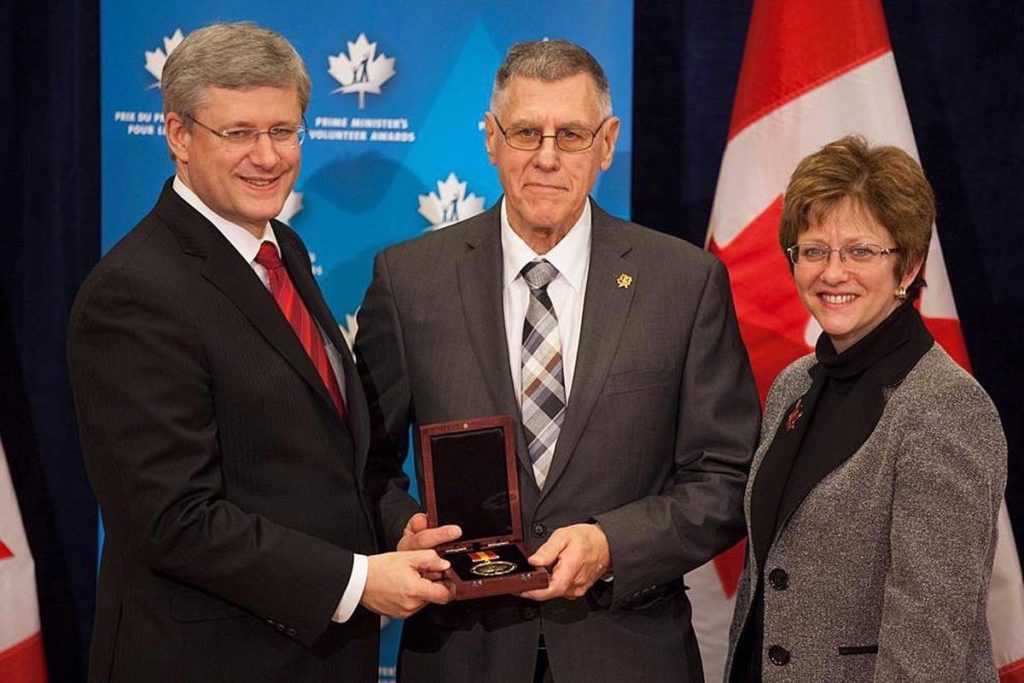 Rich Goulet receives a volunteer award from then Prime Minister Stephen Harper. (Contributed)