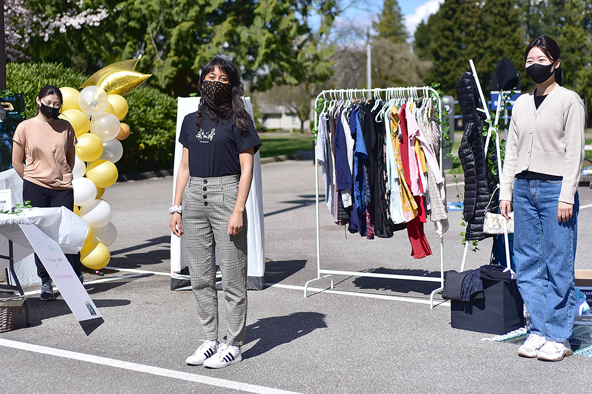 Florence Song (left), Amy Saya, and Chanhee Park participated in sustainability week at TWU by selling clothes to benefit charities. (TWU's Winnie Lui/Special to Langley Advance Times)