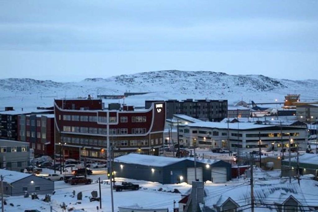 Downtown Iqaluit, Nunavut, is shown after a 2 p.m. sunset on Tuesday, Nov. 24, 2020. Nunavut's capital city is under a strict lockdown after its first case of COVID-19 since the start of the pandemic was reported Wednesday night. THE CANADIAN PRESS/Emma Trante