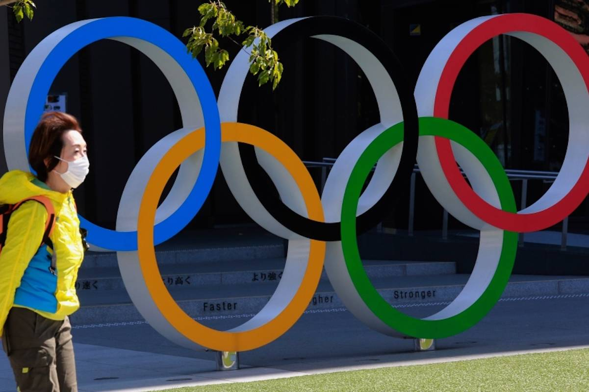 A woman walks past the Olympic rings in Tokyo, Wednesday, March 10, 2021. (AP Photo/Koji Sasahara) A woman walks past the Olympic rings in Tokyo, Wednesday, March 10, 2021. (AP Photo/Koji Sasahara)
