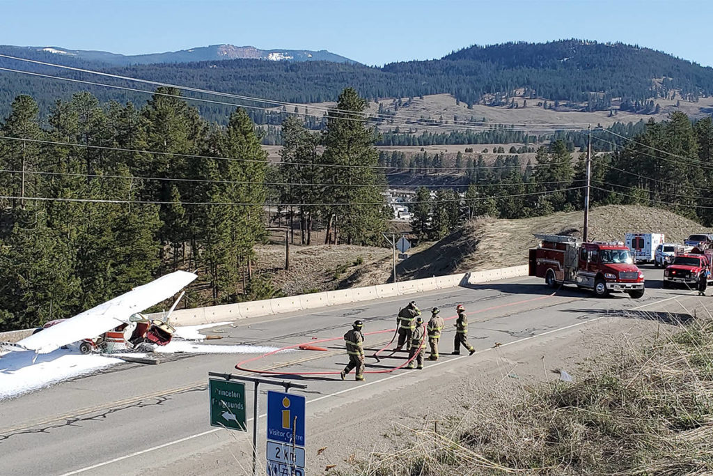 The plane blasted through an airport fence and down a hill, before stopping before a cement barrier on Highway 5A, right in front of a school bus. Photo submitted.