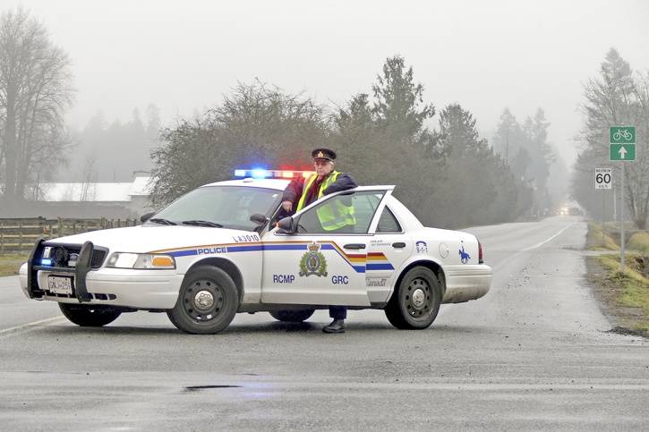 Police blocked off 40th Avenue on Jan. 10, 2015 while firefighters battled a meth lab blaze. The fire has led to a lawsuit against Langley Township. (Langley Advance Times files)