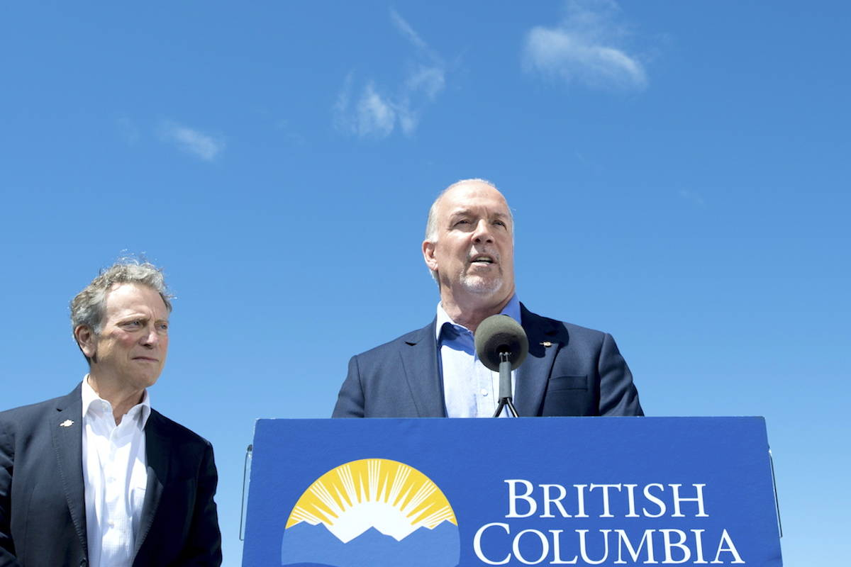 B.C. Premier John Horgan and Minister of Environment and Climate Change George Heyman (left). THE CANADIAN PRESS/Jonathan Hayward
