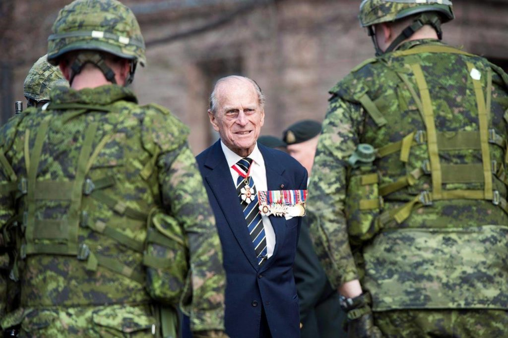 HRH Prince Philip chats with members of the 3rd Battalion of The Royal Canadian Regiment at the Ontario Legislature in Toronto, Saturday, April 27, 2013. The options for Canadians planning to pay their respects to Prince Philip during his funeral Saturday will be largely limited to small gatherings in front of computer or TV screens, thanks to pandemic protocols. THE CANADIAN PRESS/Frank Gunn