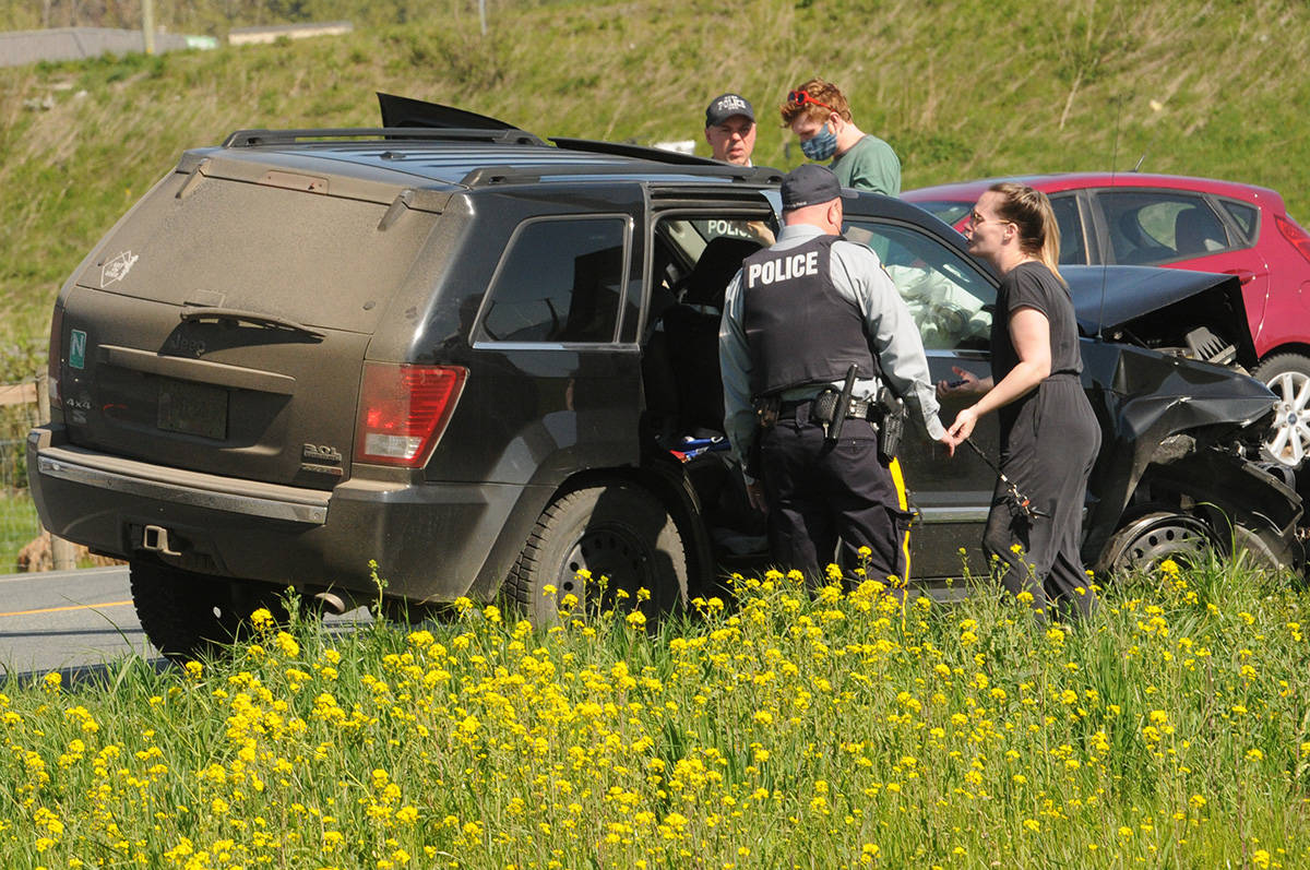 The female driver of this Jeep Grand Cherokee (right) was driving erratically with a young child inside on Highway 1 eastbound. After hitting a barrier and a parked car, she finally exited the highway at Yale Road West and came to a stop. (Jenna Hauck/ Chilliwack Progress)