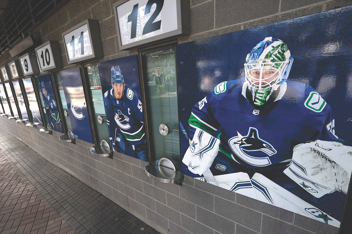 Photos of Vancouver Canucks players are pictured outside the closed box office of Rogers Arena in downtown Vancouver Thursday, April 8, 2021. THE CANADIAN PRESS/Jonathan Hayward