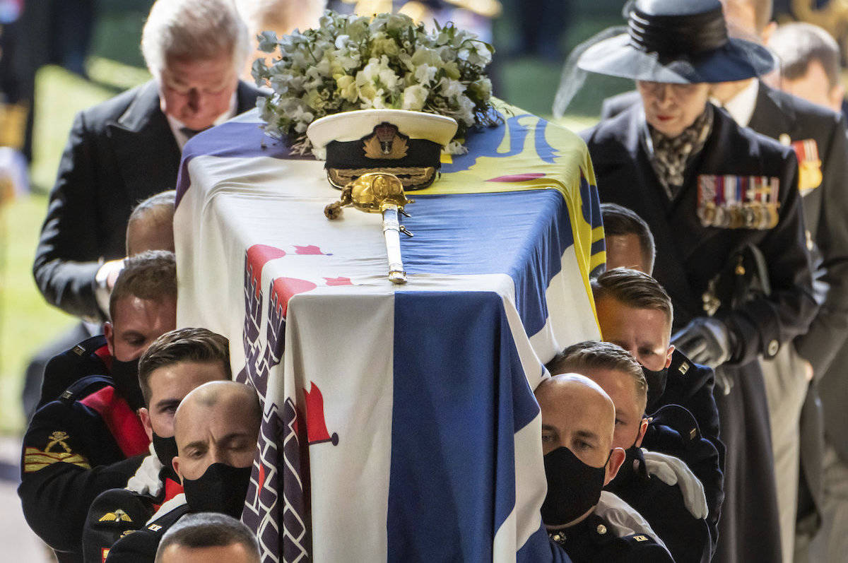 Pall Bearers carrying the coffin of the Duke of Edinburgh, followed by the Prince of Wales, left and Princess Anne, right, into St George's Chapel for his funeral, at Windsor Castle, in Windsor, England, Saturday April 17, 2021. (Danny Lawson/Pool via AP)