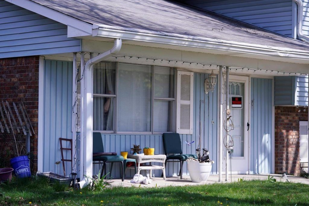 The home of 19-year-old Brandon Scott Hole, the suspected shooter who opened fire with a rifle at a FedEx facility, is seen in Indianapolis, Friday, April 16, 2021. At a news conference Friday, Deputy Police Chief Craig McCartt also confirmed the gunman's identity as Hole. McCartt said Hole was a former employee of the company and last worked for FedEx in 2020. (AP Photo/Michael Conroy)