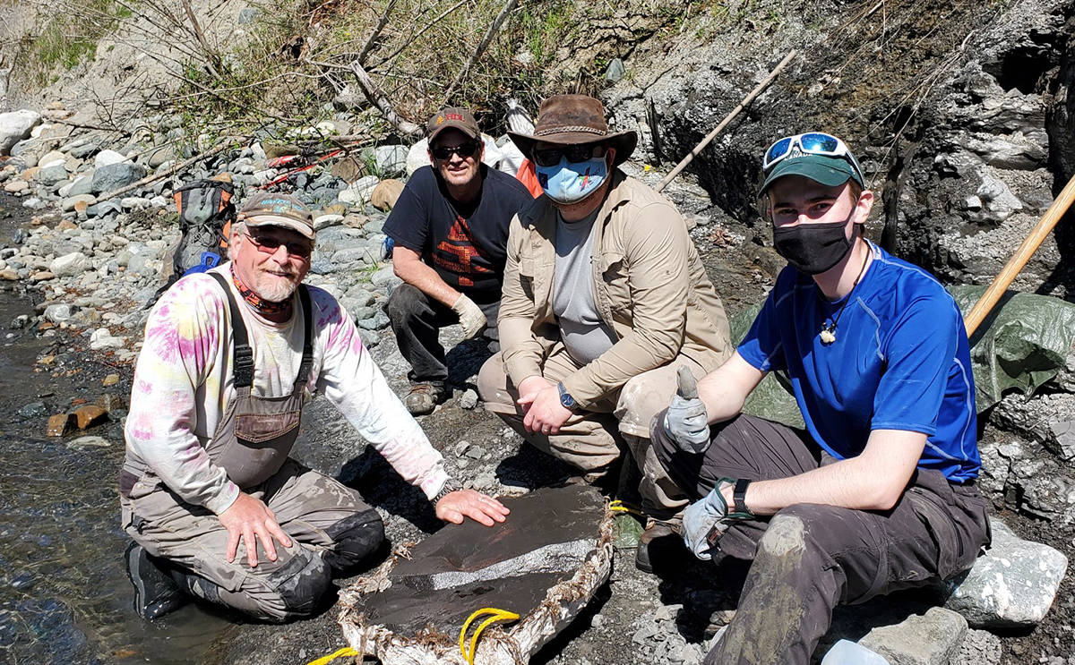 Russ Ball (left) and some of the team show off the specimen after they were able to remove it Friday. Photo supplied