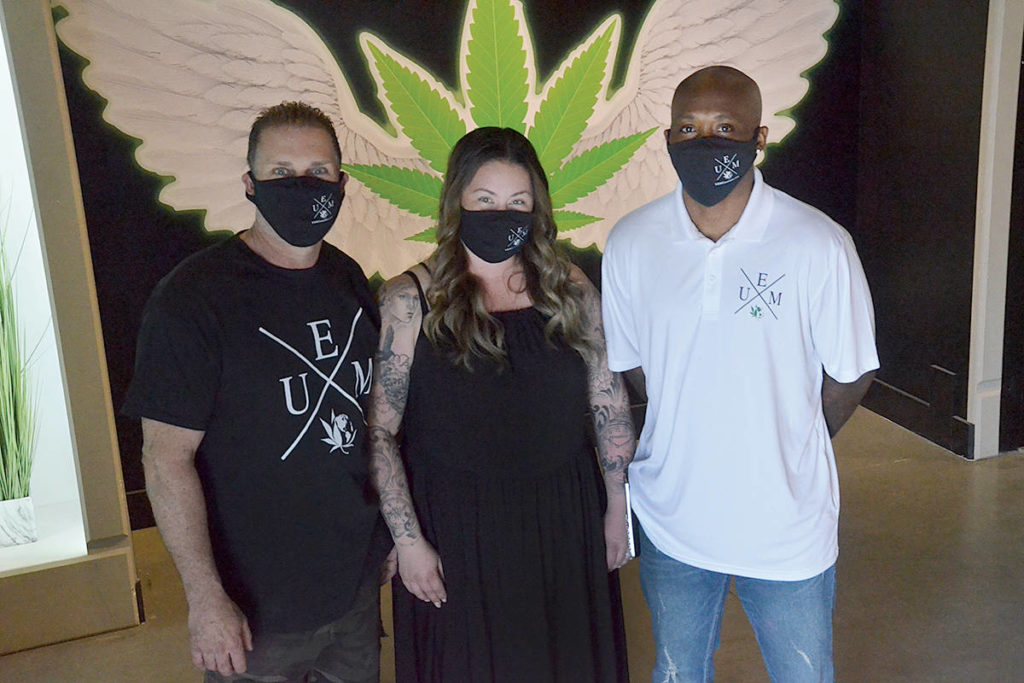 From left, Michael Young, Carli Jackson, and Lee Jackson are family and owners of the