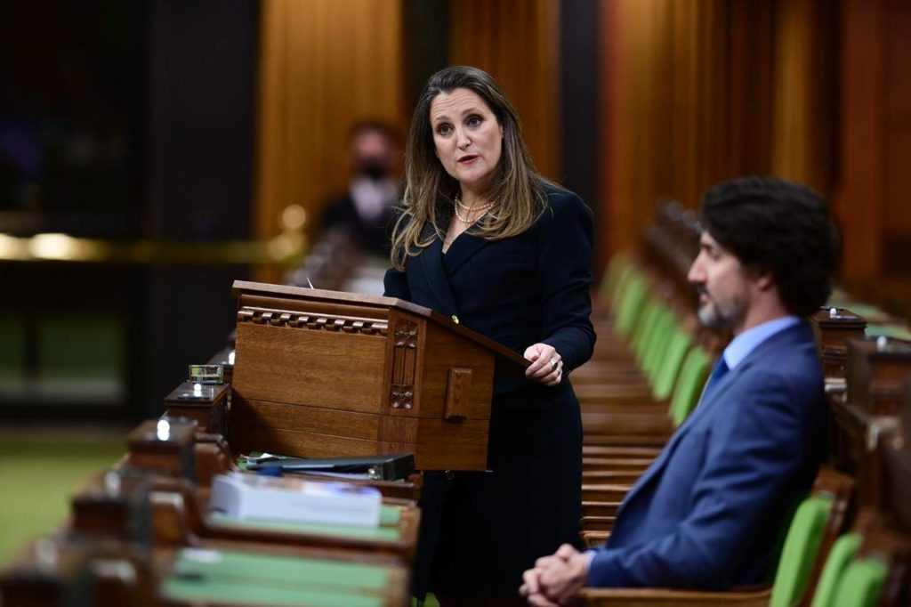 Finance Minister Chrystia Freeland delivers the federal budget in the House of Commons as Prime Minister Justin Trudeau looks on in Ottawa on Monday April 19, 2021. The federal government unveiled spending plans to manage the remainder of the COVID-19 crisis and chart an economic course for a post-pandemic Canada. THE CANADIAN PRESS/Sean Kilpatrick