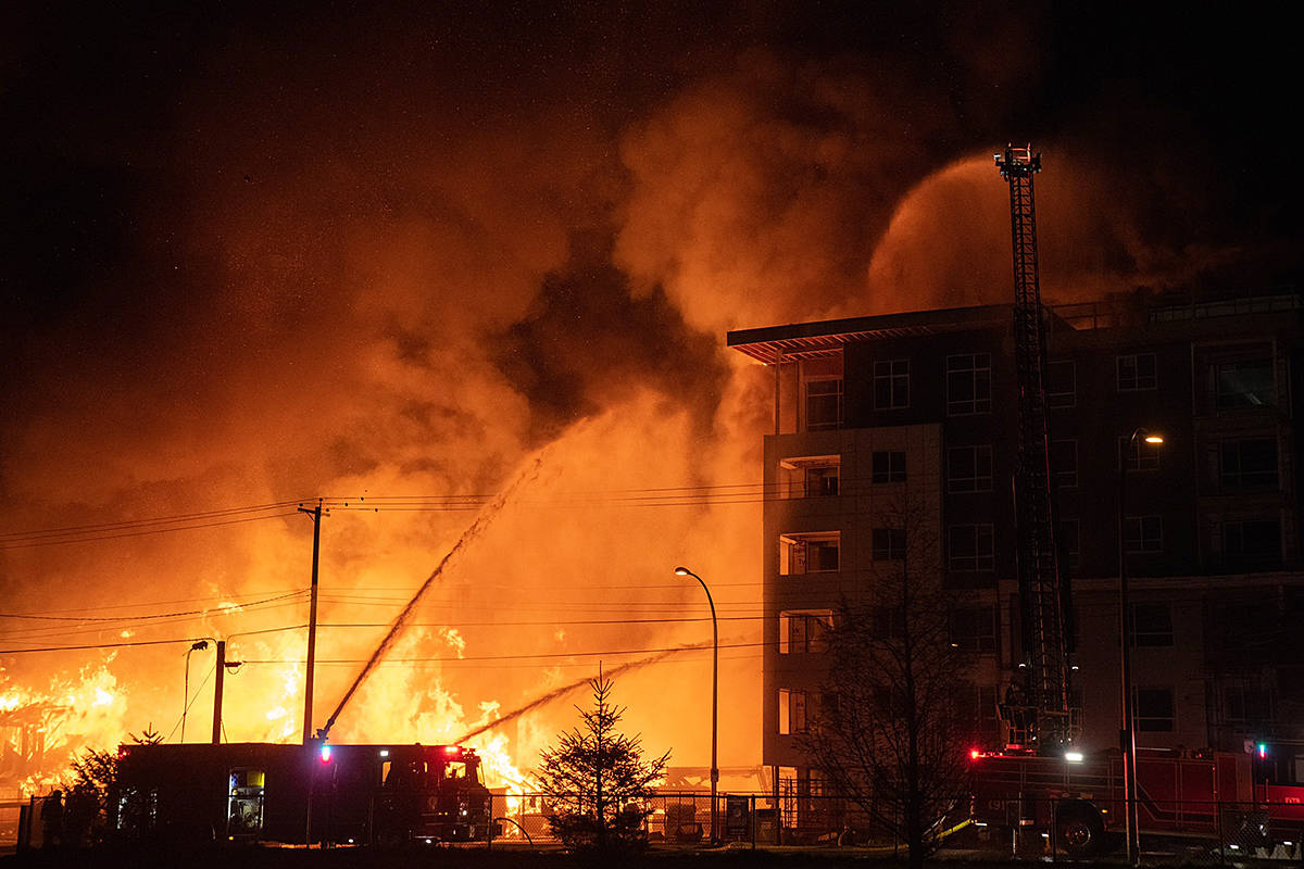Fire consumed a condo development project under construction at 208th Street and 80th Avenue Monday night. Many spectators shared their images. (Daniel Gerstner/Instagram: @gerstner/Special to Langley Advance Times)