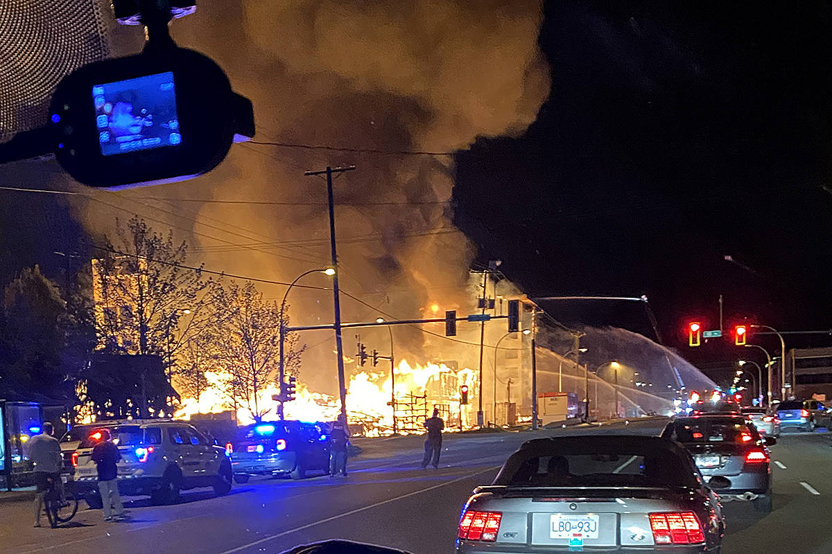 Fire consumed a condo development project under construction at 208th Street and 80th Avenue Monday night. Many spectators shared their images. (Ryan Thivierge/Special to Langley Advance Times)