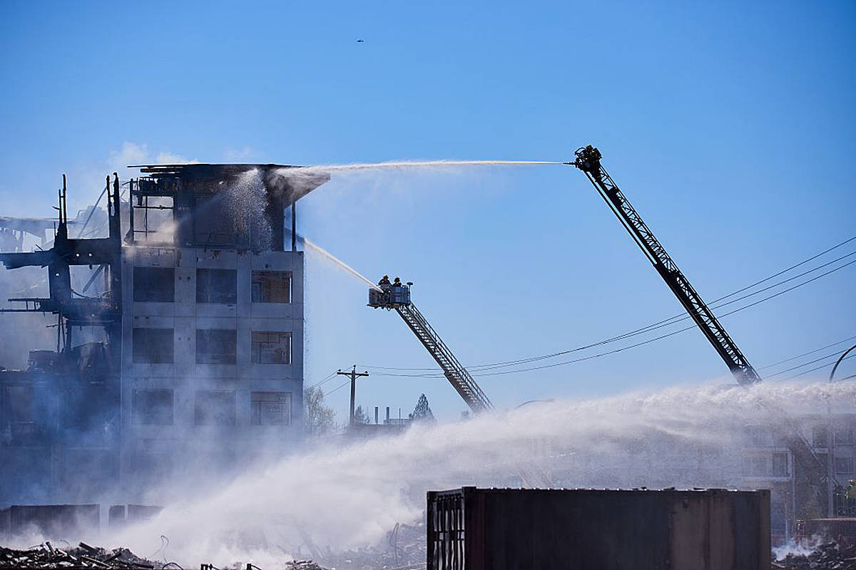 Firefighters were still working to put out a condo fire that began the night before at 80th Avenue and 208th Street on April 20. (Rob Wilton/Special to the Langley Advance Times)