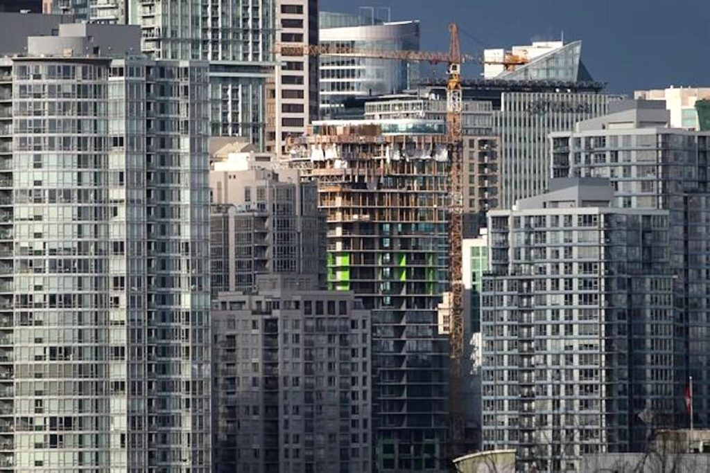 A condo tower under construction is pictured in downtown Vancouver on February 9, 2020. Experts and advocates say budget measures aimed at putting housing within reach of more Canadians mark a step in the right direction, despite a few ham-fisted moves. THE CANADIAN PRESS/Darryl Dyck