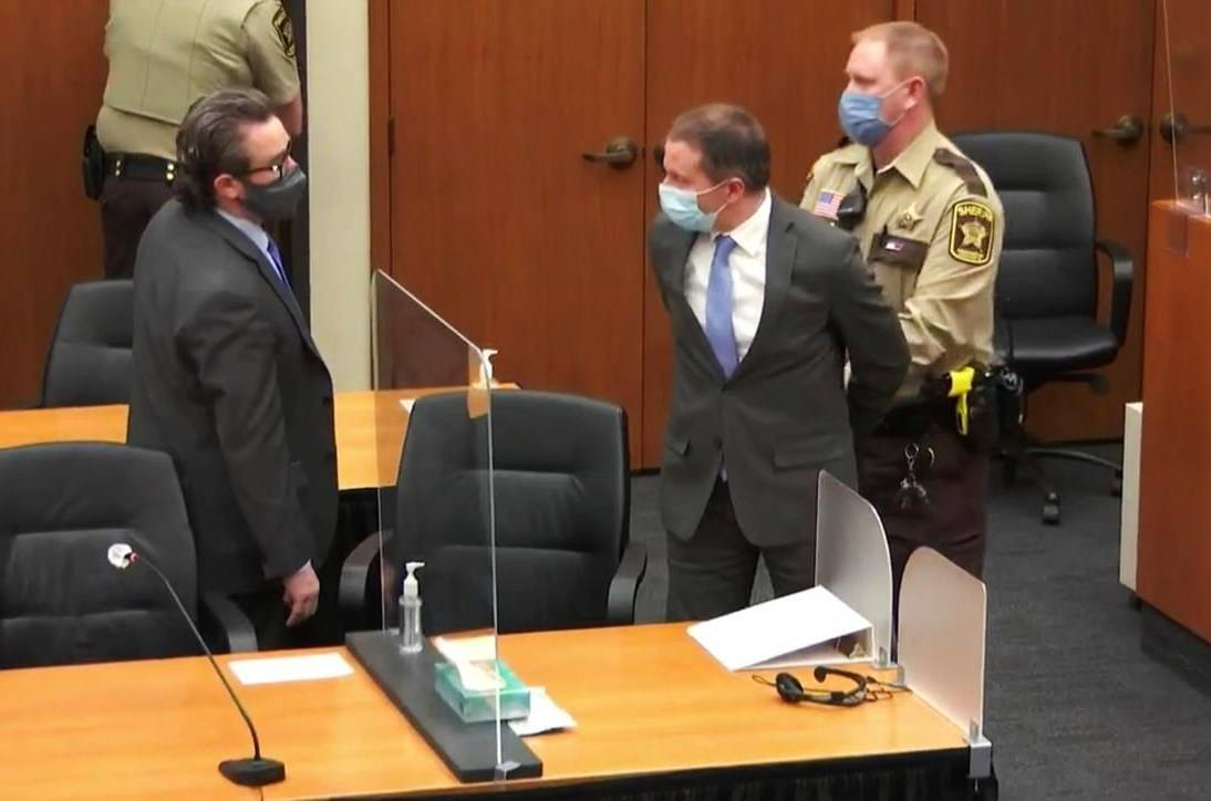 In this image from video, former Minneapolis police Officer Derek Chauvin, center, is taken into custody as his attorney, Eric Nelson, left, looks on, after the verdicts were read at Chauvin's trial for the 2020 death of George Floyd, Tuesday, April 20, 2021, at the Hennepin County Courthouse in Minneapolis, Minn. THE CANADIAN PRESS/Court TV via AP, Pool