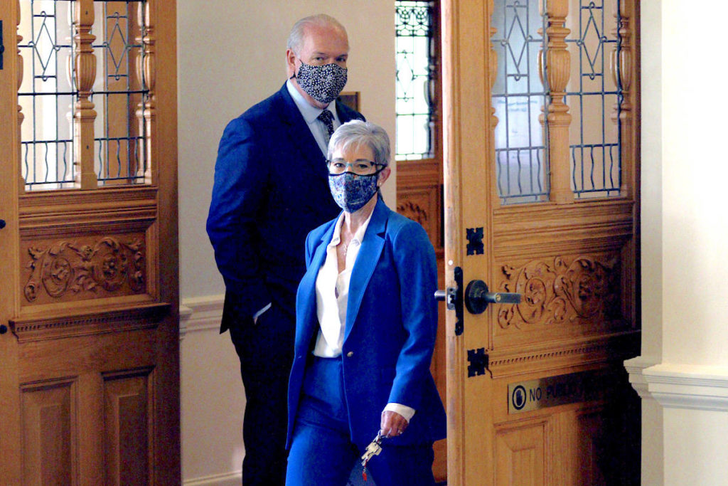 B.C. Finance Minister Selina Robinson leaves the assembly with Premier John Horgan after the budget speech Tuesday, April 20, 2021. THE CANADIAN PRESS/Chad Hipolito