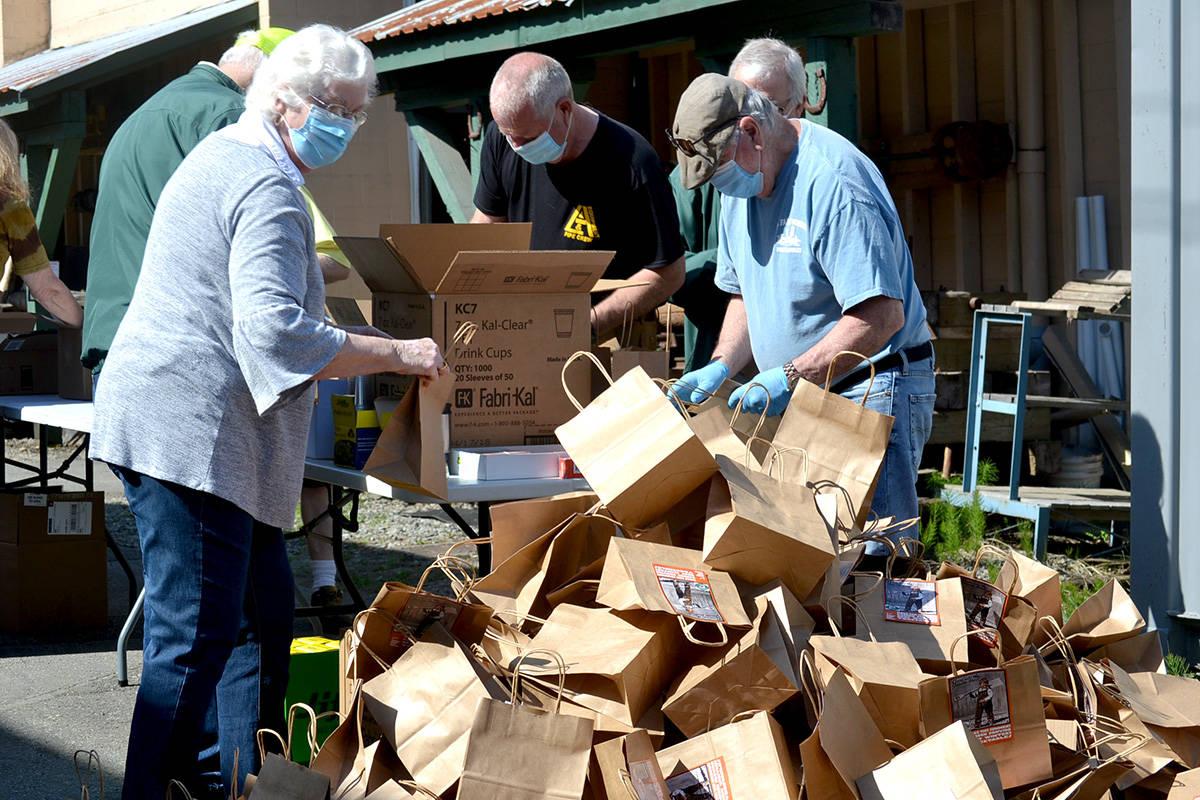 Seniors spent the morning packaging seeds at the BC Farm Museum. (Ryan Uytdewilligen/Aldergrove Star)