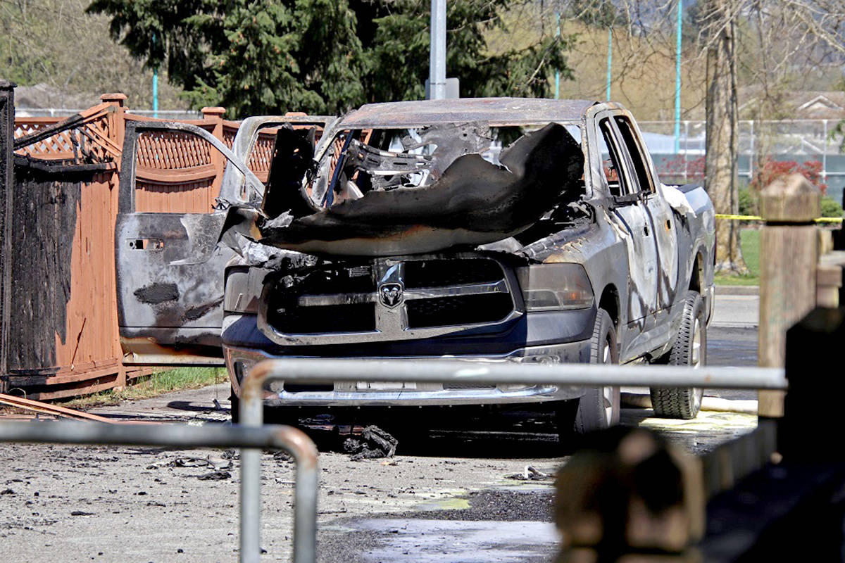 A torched vehicle found in Port Coquitlam is thought to be linked to the shooting in Langley. (Shane MacKicha/Special to The Star)