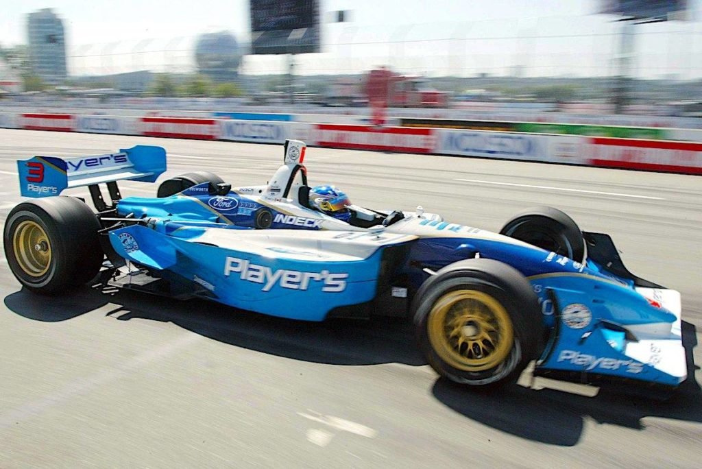 Canadian driver Paul Tracy pulls out of the pits during the morning session at the Molson Indy in Vancouver, B.C., Saturday, July 26, 2003 (CP/Richard Lam)