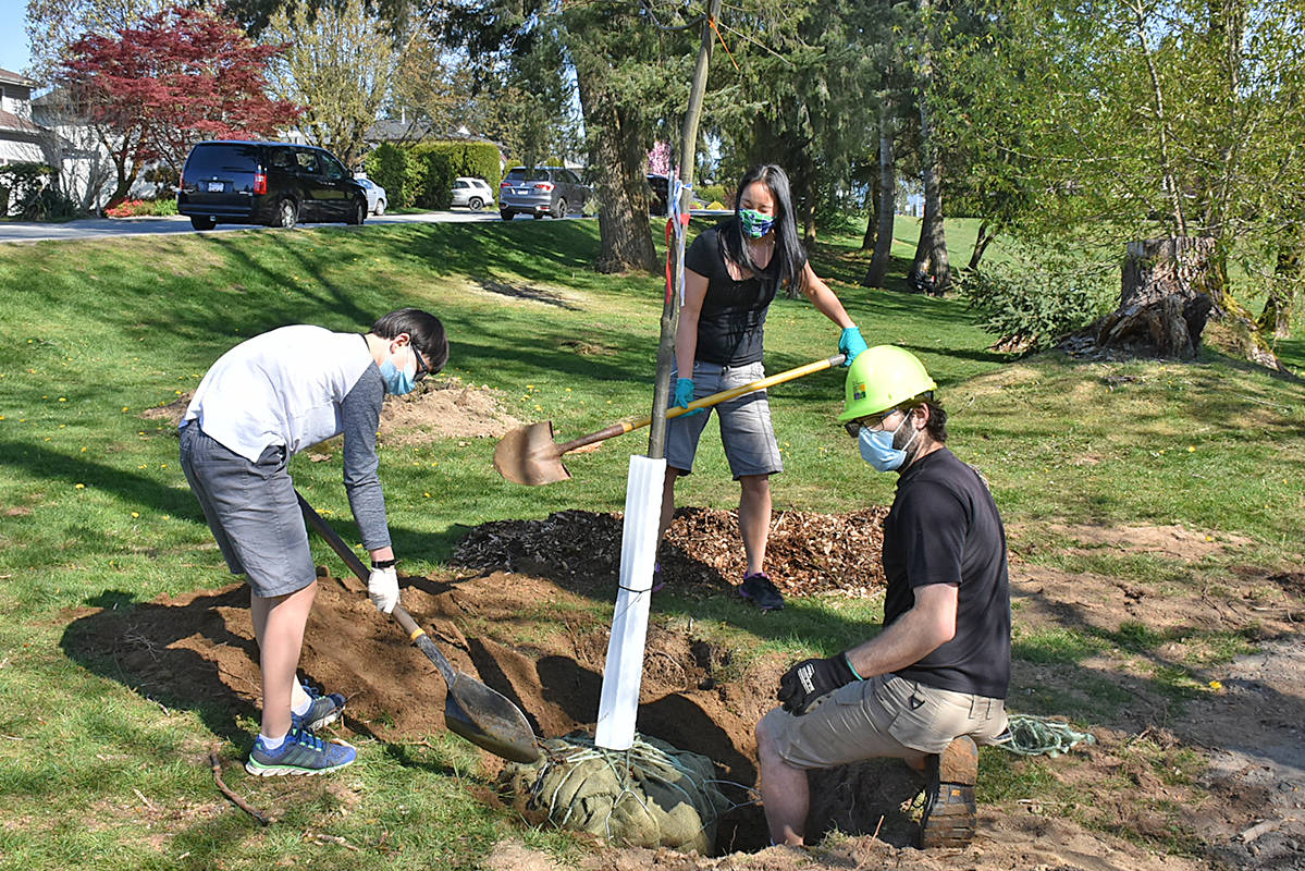 Caleb Unger, 11, and his mother Elaine volunteered for the Earth Day tree planting event in Bonson Park, and planted a fiery oak. (Neil Corbett/The News)