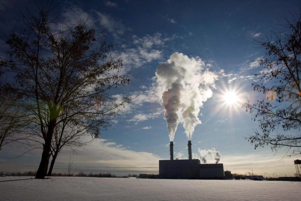 Smoke pours from the stacks at the Portlands Energy Centre in Toronto on Thursday January 15, 2009. THE CANADIAN PRESS/Frank Gunn
