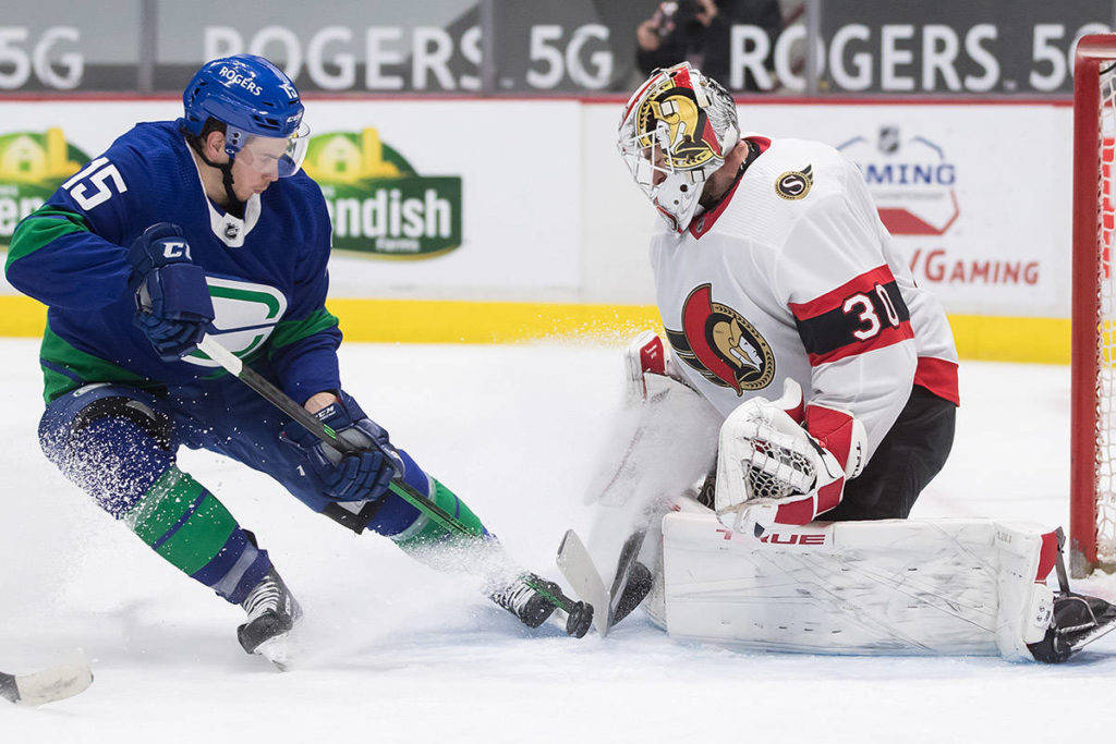 Ottawa Senators goalie Matt Murray (30) stops Vancouver Canucks' Matthew Highmore (15) during the second period of an NHL hockey game in Vancouver, on Thursday, April 22, 2021. THE CANADIAN PRESS/Darryl Dyck