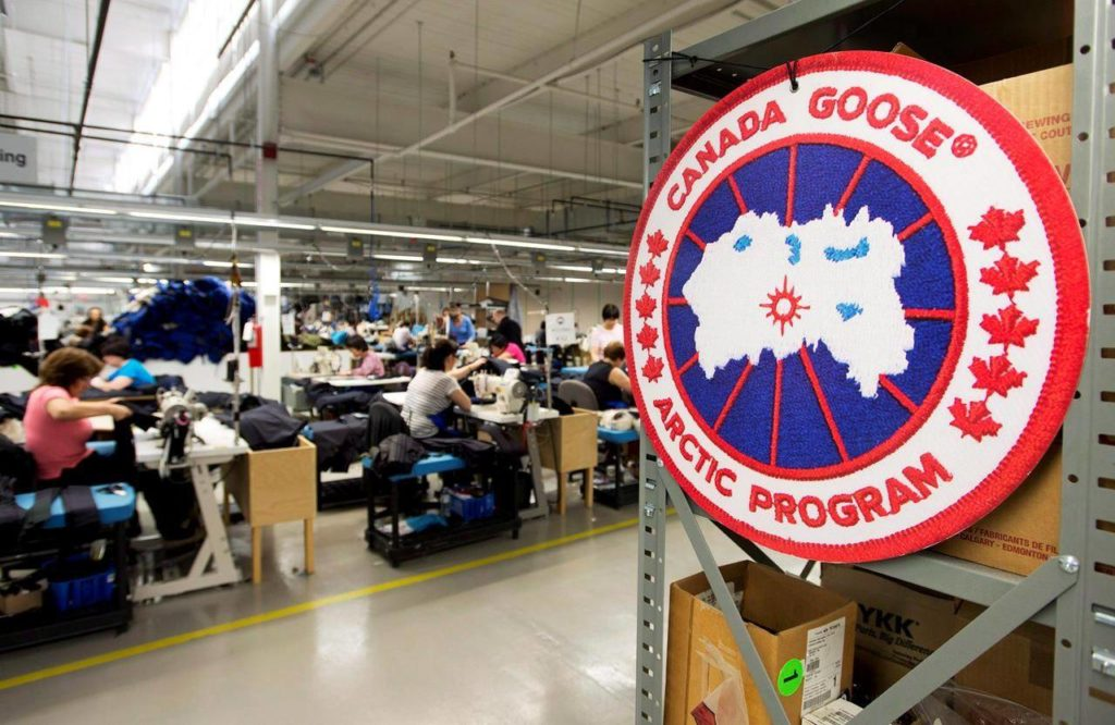 Employees work with Canada Goose jackets at the Canada Goose factory in Toronto on Thursday, April 2, 2015. THE CANADIAN PRESS/Nathan Denette