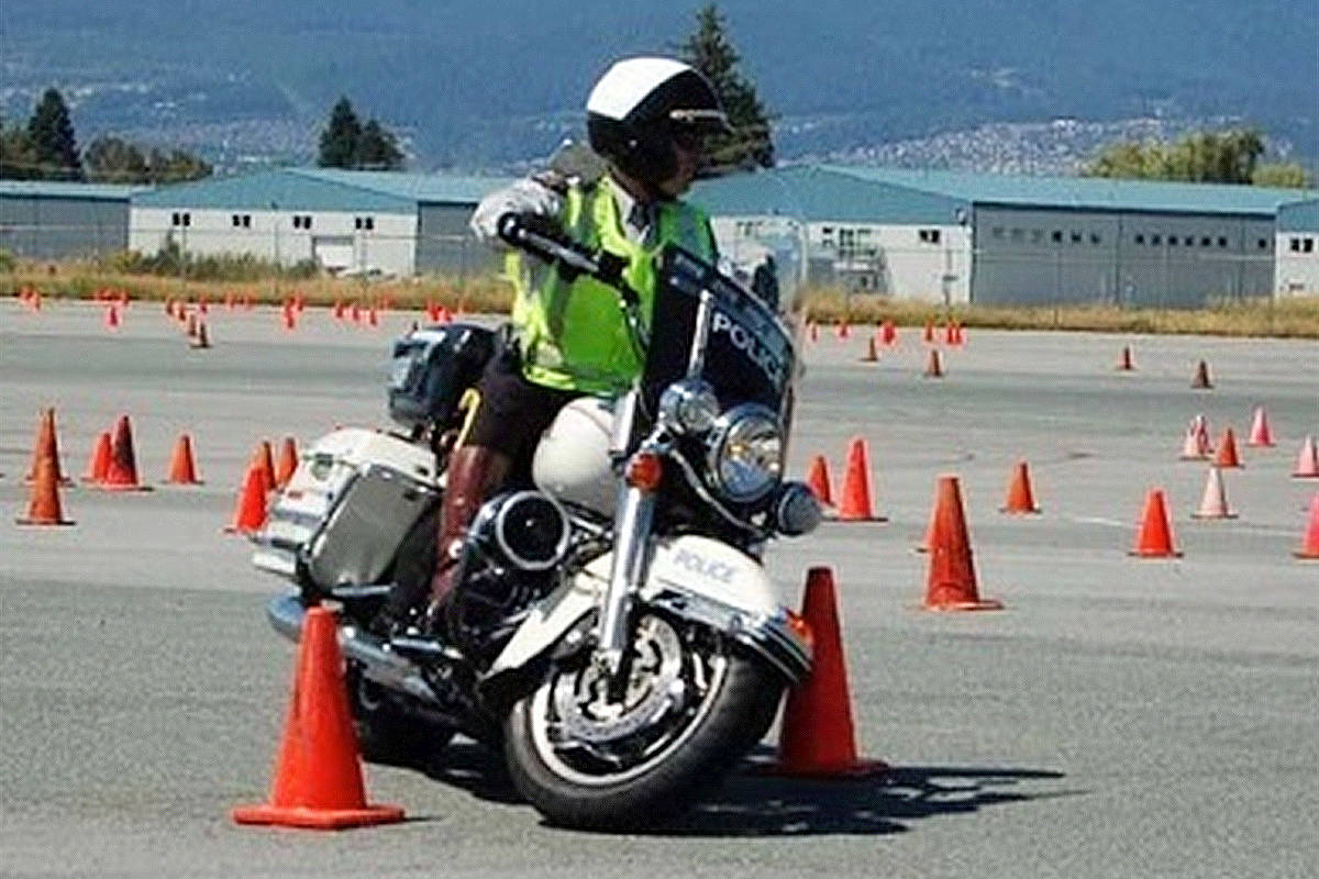 A motorcycle instructor going through a traffic cone course. (Photo courtesy of BC Traffic Services)