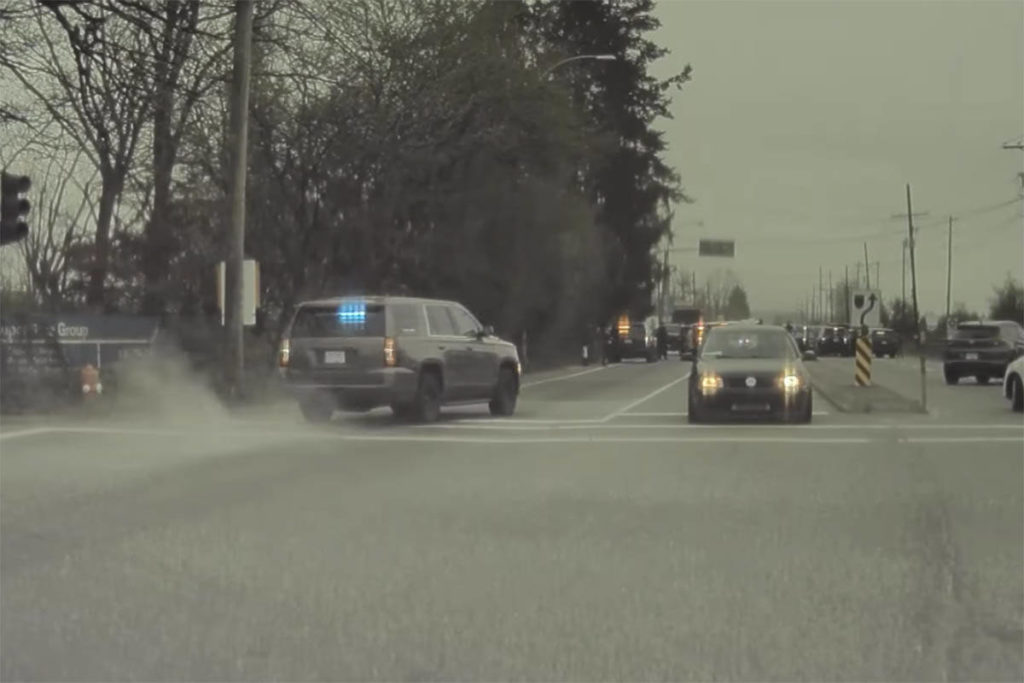 A police vehicle races to block of the road shortly before the suspected car jacker is arrested. Screenshot from Jay Lutz video.