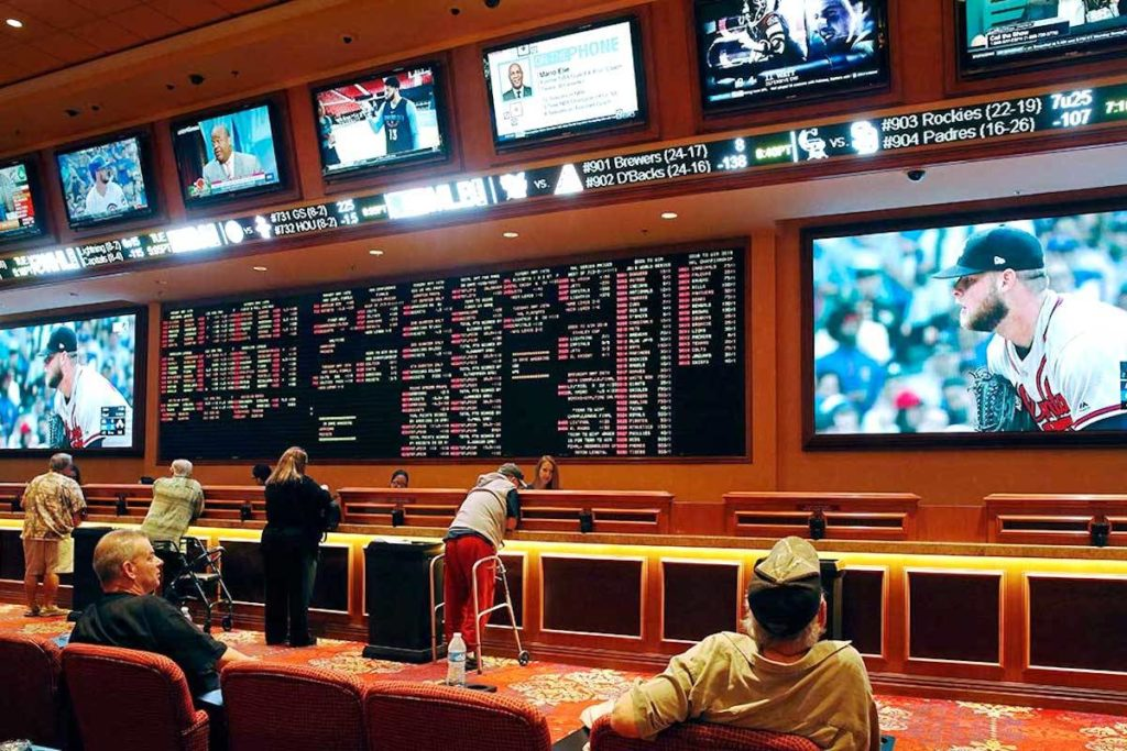 People make bets in the sports book at the South Point hotel and casino in Las Vegas. Nevada. (John Locher/AP)