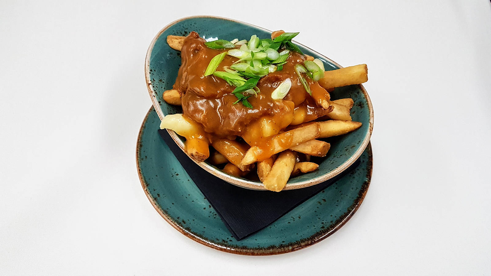 For Mealshare's annual Poutine with Purpose event, LURE Restaurant and Bar presents its Pulled Pork Poutine – house-smoked pulled pork, Kennebec fries tossed with fresh Armstrong, B.C. cheese curds, finished with Lure's chicken-duck gravy.
