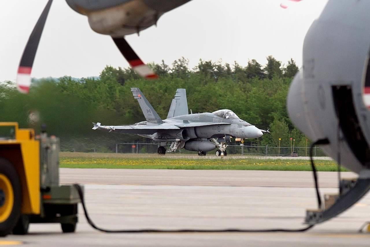 An RCAF CF-18 prepares for takeoff at CFB Bagotville, Que. on Thursday, June 7, 2018. A senior air force officer says Canada's military pilots are in danger of losing their edge as COVID-19 restrictions curtail their ability to conduct training exercises and other flying. THE CANADIAN PRESS/Andrew Vaughan