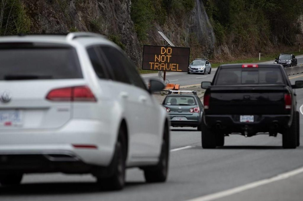 "A digital sign with the message ""Do Not Travel"" sits on the median as motorists travel on the Sea-to-Sky highway between Horseshoe Bay and Lions Bay, B.C., on Friday, April 23, 2021. THE CANADIAN PRESS/Darryl Dyck"