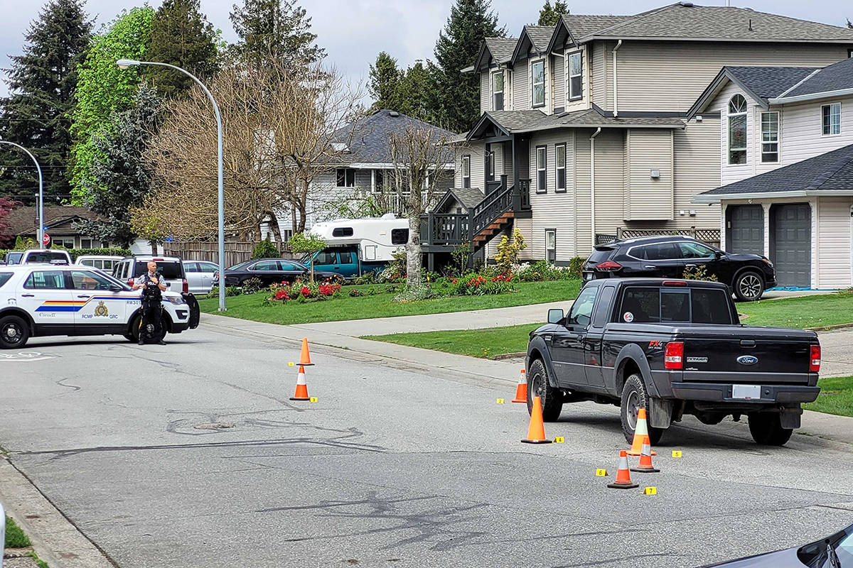 RCMP are in the 18800-block of 122nd Avenue in Pitt Meadows Monday morning (April 26, 2021) as they investigate an overnight shooting that targeted the wrong home. (Neil Corbett/The News)