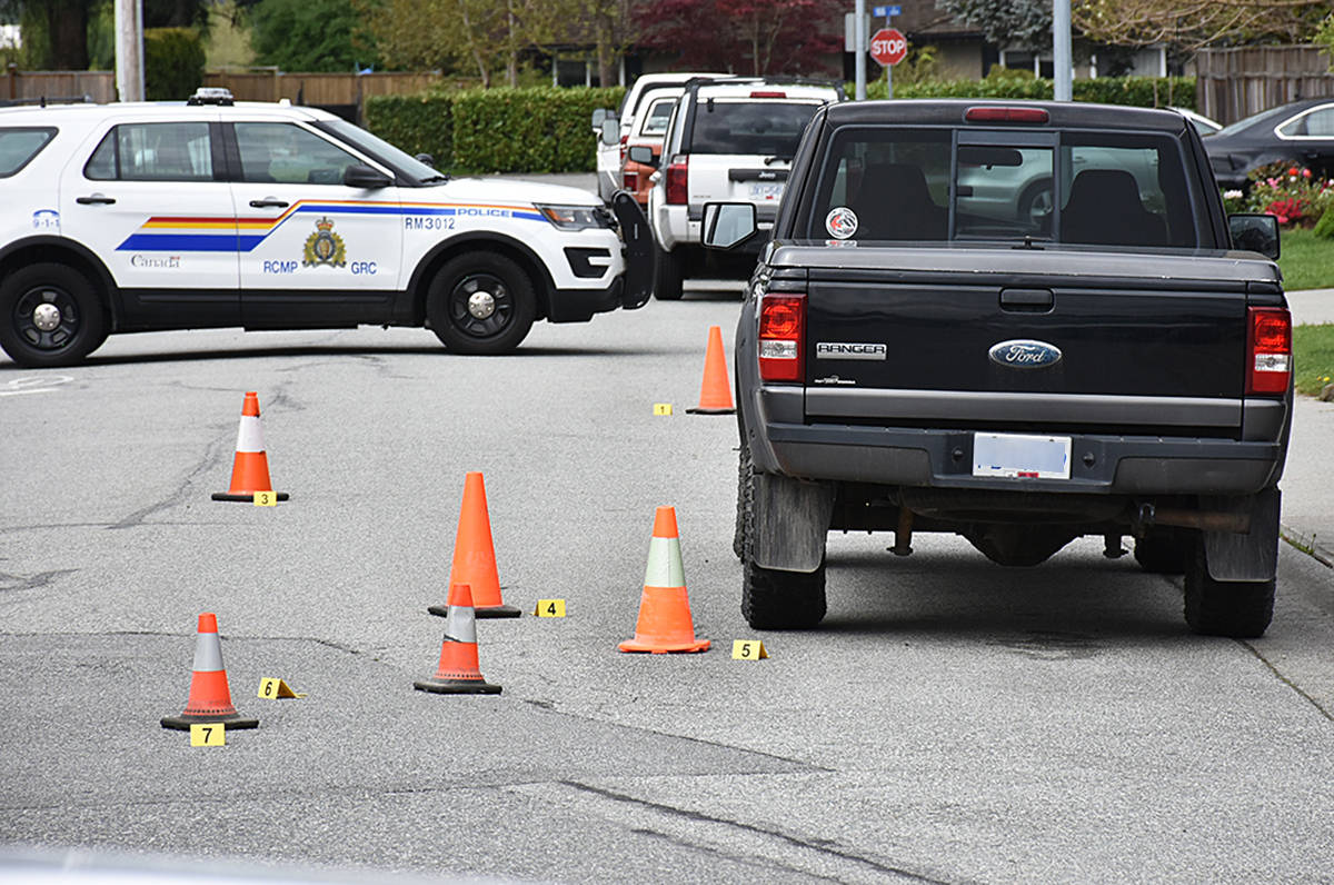 RCMP mark shell casings in the 18800-block of 122nd Avenue in Pitt Meadows Monday morning (April 26, 2021) as they investigate an overnight shooting that targeted the wrong home. (Neil Corbett/The News)