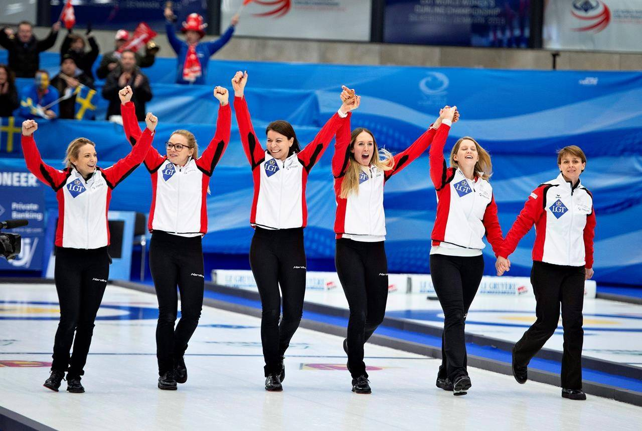Switzerland's celebrates after the finale match at the Women's Curling World Championship in Silkeborg Denmark Sunday March 24. 2019. THE CANADIAN PRESS/AP, Ritzau Scanpix - Henning Bagger