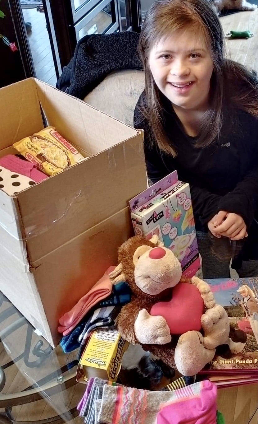 Shaylyn Allen packs up donations for delivery to Nunavut. (Contributed photo)