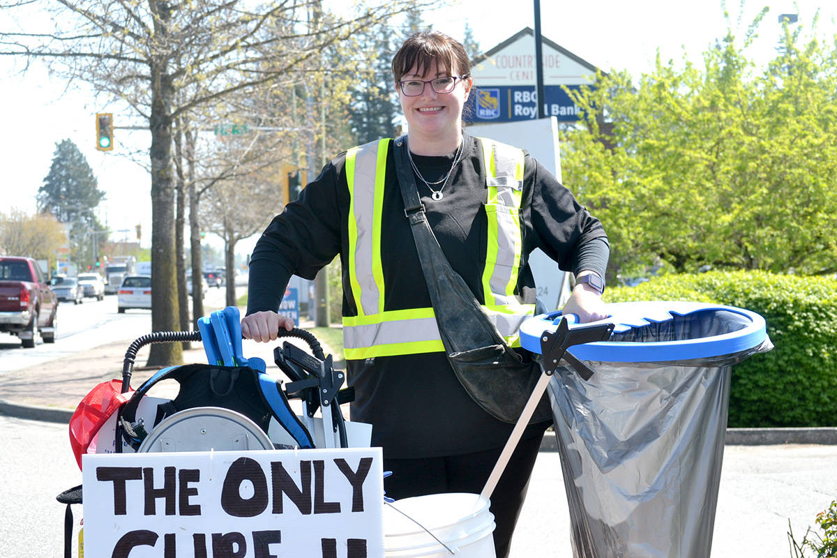 Jocelyn Titus, founder of Earth Ninjas, picks garbage along Fraser Highway in Aldergrove on Earth Day. (Ryan Uytdewilligen/Aldergrove Star)