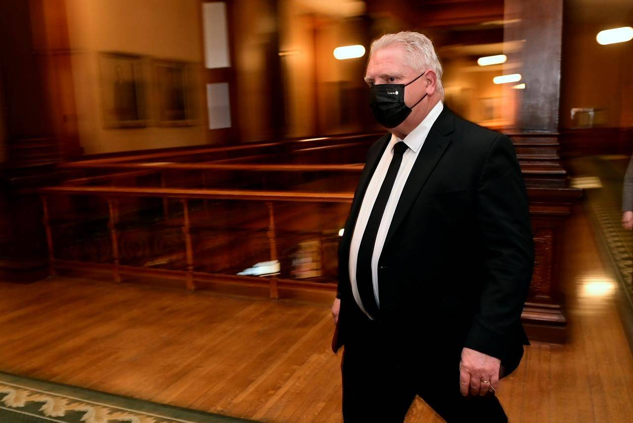 Ontario Premier Doug Ford walks to a press conference at Queen's Park in Toronto on Friday, April 16, 2021. THE CANADIAN PRESS/Frank Gunn