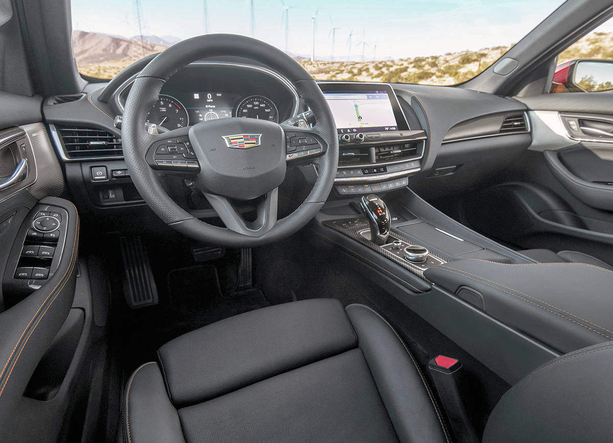 """It might look like the normal CT5 interior, but there's a Race mode and two levels of Sport mode, paddle shifters and a little """"V"""" button on the steering wheel the makes the car sound louder. PHOTO: CADILLAC"""