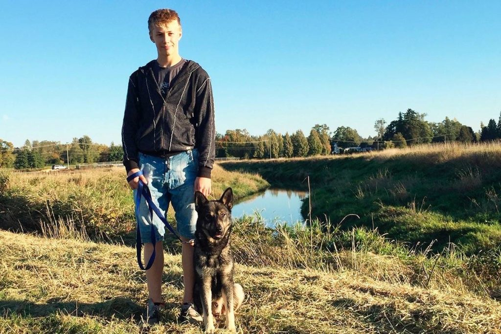 Travis Selje with Rex, the family dog he got to enjoy for the final six months of his life. (Submitted photo)